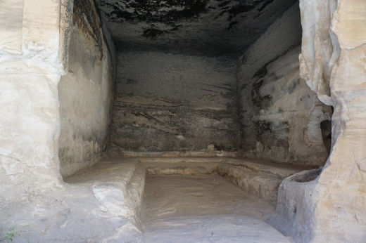 This is an example of a Triclinium, an open face eating area carved into the sandstone mountains.