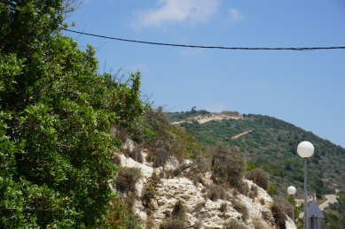 """In the distance, one of the silos for the """"Iron Dome"""" built by Israel to defend against rocket attacks"""
