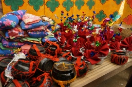 The blankets, pillows and food pots for the new child monks and flowers for the single women of the village